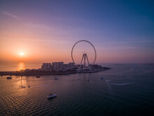 Aerial View Of Ain Dubai, The World's Largest Ferris Wheel At Sunset With Many Motorboat Sailing The Persian Gulf, Dubai, United Arab Emirates.