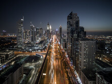 Aerial View Of Sheikh Zayed Road In Dubai City Centre, A Busy And Large Traffic Road In Dubai Downtown Running Among Tall Skyscrapers At Night, Dubai, United Arab Emirates.