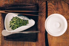 Chinese Tea Ceremony.Porcelain White Gaiwan,Cha Hae With Tea On A Wooden Chaban.
