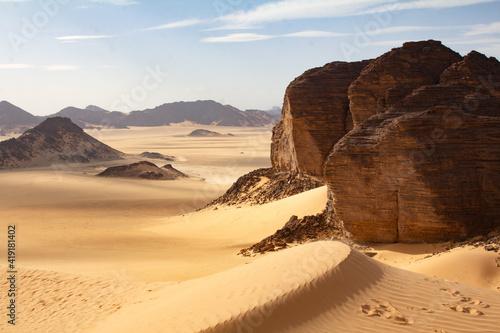 Fotografiet Sandy rocks in Sahara desert, Algeria desert