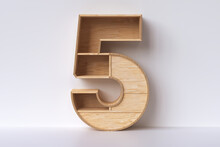 """Wood Number """"5"""" 3d Rendering. Wooden Furniture And Decoration Concepts."""