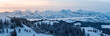 canvas print picture - panoramic view on a beautiful winter sunrise in snowy Emmental