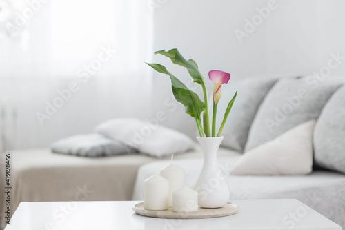 Obraz flowers in vase on white table indoor - fototapety do salonu