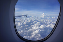 Beautiful Shot Of Fluffy Clouds From An Airplane Window