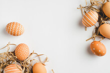 Happy Easter Concept. Frame Of Elegant Easter Eggs On White Background. Flat Lay, Top View, Copy Space.