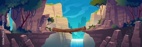 Obraz na płótnie Log bridge between mountains above cliff in rocks