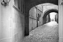 Cobblestone Path Under Arches In An Old Building