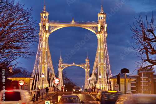 The Albert Bridge is a road bridge over the River Thames in London Poster Mural XXL