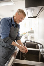 Food Truck Owner Washing Hands At Sink