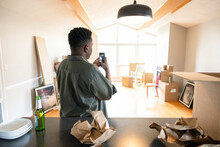 Man With Camera Phone Moving Into New Home