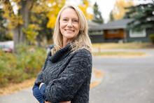 Portrait Beautiful Mature Woman In Sweater On Autumn Street