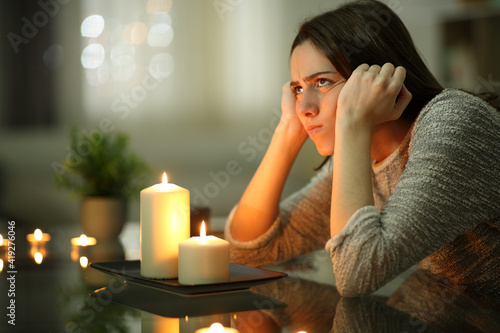 Fototapeta Angry homeowner using candles during power outage obraz