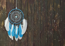 Beautiful Handmade Boho Dreamcatcher With Blue Feathers And Copy Space.