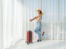Young Asian Woman Wearing Casual Being Ready To Go On Vacation Travelling Trip With Travel Trolly Bag Luggage. People Lifestyle.