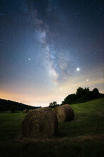 Hay Bales In A Grassy Field Just Outside Of Shenandoah National Park With The Milky Way Shining High Above