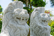 Marble White Lion Statue In Outdoors Park, Vietnam. Close Up