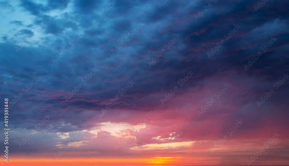 Fototapeta Colorful dramatic sky with clouds at sunset, nature background