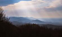 Afternoon Crepuscular Rays Illuminating Over Shenandoah National Park In The Early Parts Of Winter.