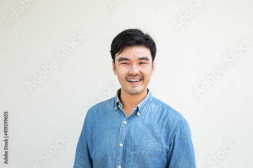 adult asian man.young male person wear eye glasses.posing smiling laughing look excited surprised thinking positive happy.empty,copy space for text advertising.white background.attractive fashion