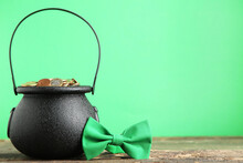 Pot Of Gold With Bow Tie On Green Background. Concept St.Patrick's Day