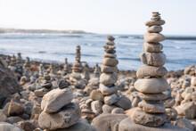 Picturesque Scenery Of Zen Stone Pyramids Created In Beach Near Waving Ocean On Sunny Day In Vila Nova De Milfontes, Portugal