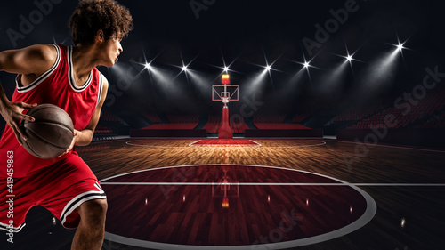 Canvastavla Young African American boy with basketball in the middle of the stadium ready to