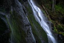 Long Time Exposure Of Water Flowing Down Rocks.