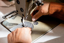 High Angle Of Crop Faceless Senior Seamstress Putting Thread Into Sewing Machine In Workshop