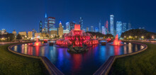 Panoramic Cityscape With Famous Buckingham Fountain Illuminated By Colorful Lights Against Contemporary Skyscrapers In Night Time In Chicago