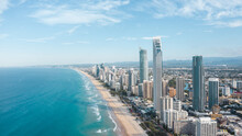 Breathtaking Aerial View Of Modern Skyscrapers Located Near Famous Sandy Surfers Paradise Beach Washing By Powerful Ocean In Queensland