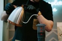 Hands Holding Hot Water To Prepare Coffee