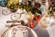 High Angle Of Served Festive Table With Crystal Glasses Cutlery Napkin On Plate Near Bunch Of Fresh Flowers For Wedding And Menu Card