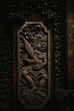 Traditional Ornate Balinese Relief Wall Panel With Carved Patterns And Image Of Hindu God With Sword