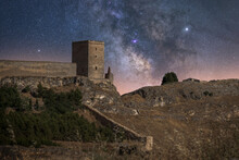 Picturesque Scenery Of Abandoned Remains Of Ancient Castle Under Milky Way