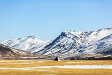Spectacular Landscape Of Wigwam Located In Valley In Highlands Covered With Snow On Sunny Day In Winter In Iceland