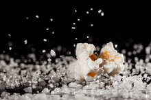 Closeup Of A Delicious Popcorn On A Layer Of Salt