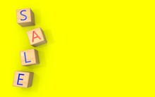 Wooden Cubes With The Letters SALE Are Laid Out On A Yellow Background. 3D Render