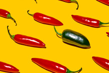 From Above Of Fresh Ripe Chili Peppers With Hot Green Vegetable Of Different Kind On Yellow Background