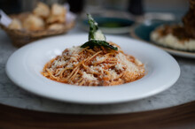 Close Up View Of Spaghetti Bolognese Dish On Restaurant Table