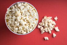 Top View Bowl Full Of Popcorn On A Red Background