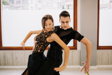 Couple Of Talented Dancers Moving Gracefully While Rehearsing Ballroom Dance In Hall During Lesson