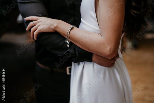 Canvas bride and groom holding hands