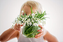 Beautiful Boy, Toddler Blond Child, Holding Spring Flowers, Beautiful Snowdrops