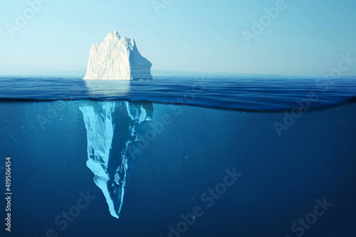 Foto Iceberg in clear blue water and hidden danger under water