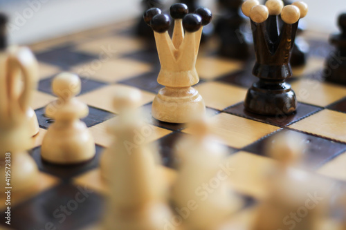 Fotografiet beige and brown wooden chess figures and chessboard