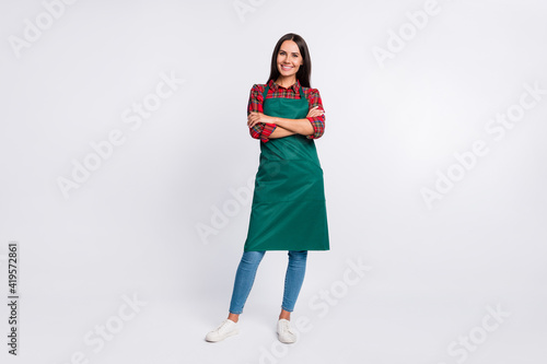 Fényképezés Full length photo of charming young lady hands folded wear green apron barista i