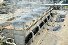Cooling Tower And Cooling Fan Blowing Steam On The Air In Chemical Plant, Refinery Plant, Oil And Gas Plant During Operation.