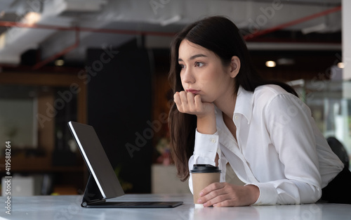 Obraz Portrait of beautiful woman on workspace at office freedom and happy. thinking looking outside. - fototapety do salonu
