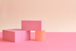 Pink and yellow abstract background with three-dimensional geometric shapes in pastel colors. Selective focus, space for text