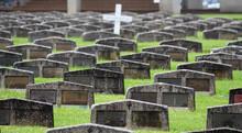 Double Plot Grave Sites. Simple Uniform Headstones Made Out Of Precast Concrete